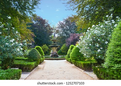 Beautiful path leading to fountain in the Botanical Garden of the University of Coimbra in Portugal. The garden was founded in the 18th century and belongs to the most popular spots in the city.
