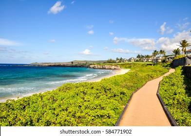 Beautiful pathway at Oneloa Bay on the island of Maui, Hawaii, USA. Oneloa Bay and Oneloa Beach are located near Kapalua on West Maui and are famous tourist destinations.