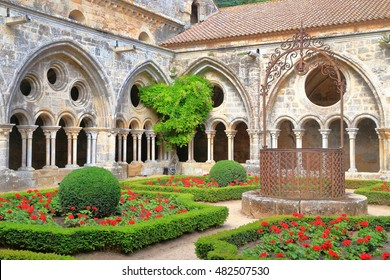 Beautiful patio surrounded by Gothic walls of the cloister of Fontfroide Abbey, Languedoc-Roussillon, France