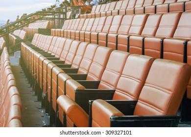 beautiful pattern of the orange seats in the stadium