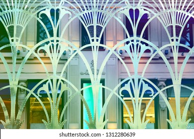 Beautiful patterned iron lattice on the background of the house photographed close-up