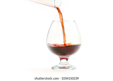 Beautiful patterns pouring into a glass of red wine