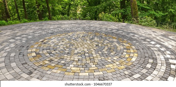 Beautiful Paving Stone Of White, Gray,  Yello Ornamental Patio Floor. Modern Rounded Decorative Area In The Park Or Garden Or In Backyard Garden