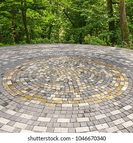 Beautiful Paving Stone Of White, Gray, Yellow Ornamental Patio Floor. Modern Rounded Decorative Area In The Park Or Garden Or In Backyard Garden