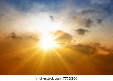 Beautiful peaceful sunset - bright sun, yellow beams