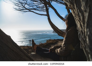 Beautiful and peaceful sunset overlooking the beach, ocean and a number of old abandoned pillars in Davenport California along the coast driving down to Monterey County