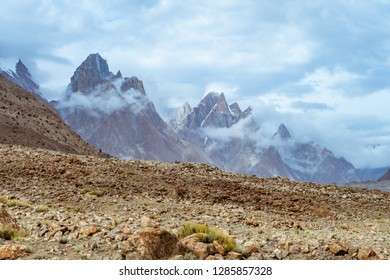Beautiful peaks of Trango Towers surrounded by clouds in Karakoram Mountain Range in Pakistan.