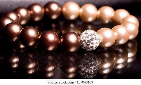 Beautiful pearl beads on black background