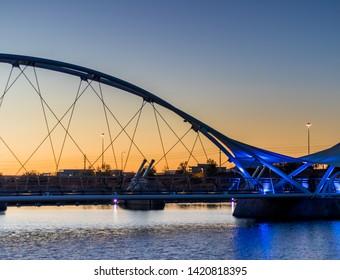 Beautiful pedestrian bridge at sunset