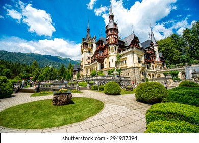 Beautiful Peles castle and ornamental garden in Sinaia landmark of Carpathian mountains in Europe