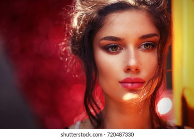 Beautiful Pensive Woman on Colorful Red and Yellow Background