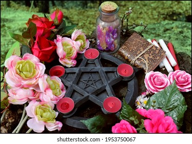 Beautiful pentagram candle holder with blooming flowers for Beltane ritual