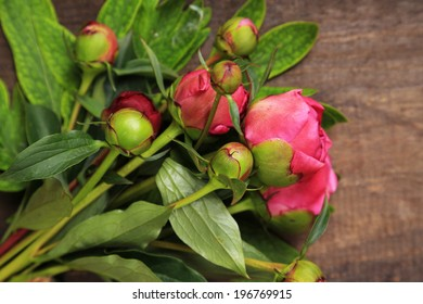 Beautiful peonies  on  wooden  background