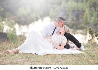 beautiful people love kissing, newlyweds, a young couple, outdoor session. The bride in a white dress. Love, wedding and passion