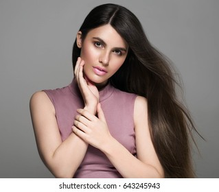 Beautiful perfect hair woman portrait. Studio shot. Gray background.
