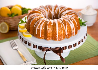 Beautiful perfect homemade lemon citrus bundt cake dessert on a dinner table