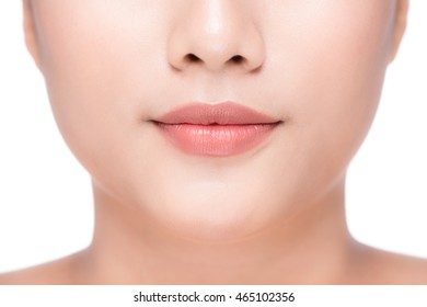 Beautiful Perfect Lips. Sexy Mouth close up. Beauty young asian woman Lips. Close up over white background