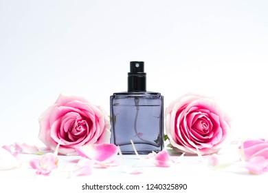 Beautiful perfume bottles on pink background
