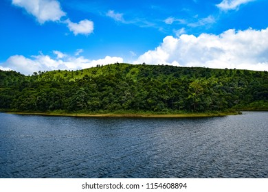 The beautiful Periyar Lake in Thekkady, Kerala, India. The entrance to the lake is via the National Park and boating in the lake is a must-do for the Thekkady travelers.
