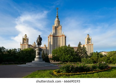Beautiful perspective of main building of moscow state university or MSU and monument of greatest russian scientist Lomonosov with blooming flowers, green trees, blue sky. Education in Russia, Moscow