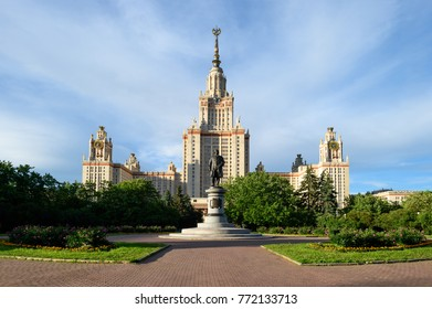 Beautiful perspective of main building of moscow state university or MSU and monument of greatest russian scientist Lomonosov with flowers, green trees, blue cloudy sky. Education in Moscow, Russia