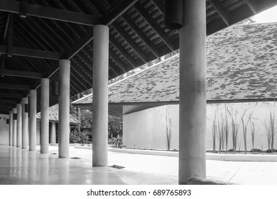 Beautiful Perspective view of long corridor and the white column row in Black and White.