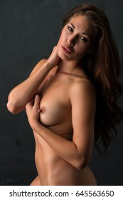 Beautiful petite brunette nude in deep shadow