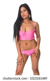 Beautiful petite Filipino woman in pink lingerie