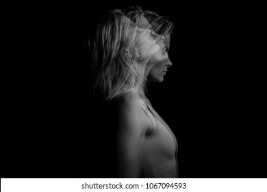 Beautiful phantom mystical mysterious ambiguous original conceptual profile side portrait of young blonde woman on a black background. Black and white photo. triple exposure.