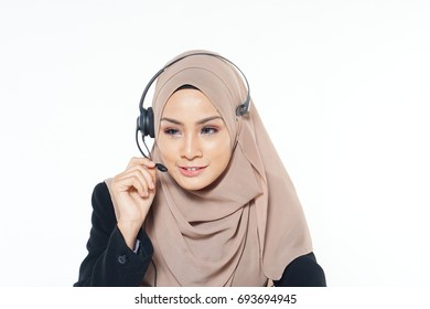 Beautiful phone operator asian woman working isolated on a white background