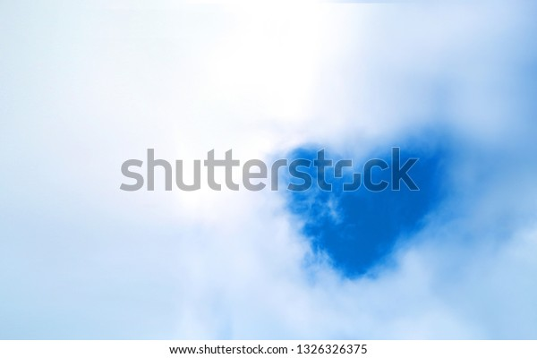 Beautiful Photo background of white clouds and a piece of blue sky in the shape of a heart
