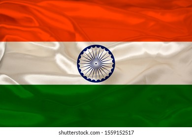 beautiful photo of the colored national flag of the modern state of india on a textured fabric, concept of tourism, emigration, economy and politics, close up