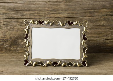 beautiful photo frame on old wooden background