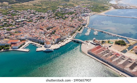 Beautiful photo of Pag on island of Pag, Croatia. Old center and the new bridge.
