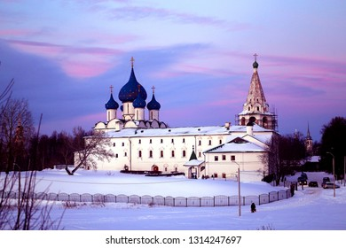 Beautiful photo of a Russian Orthodox church on a snowy field in winter