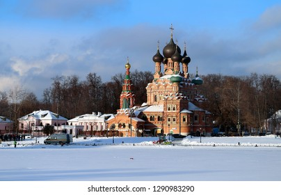 Beautiful photo of the sights of the old church in the winter park of Moscow
