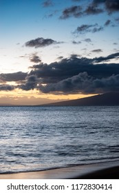 A beautiful photo of the sky and Pacific Ocean, at sunset on Kaanapali beach on the island of Hawaii.
