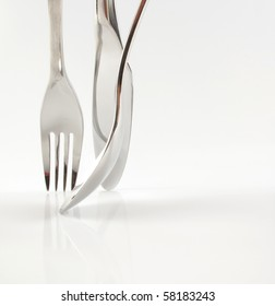 Beautiful photo of stainless steel knife fork and spoon on white