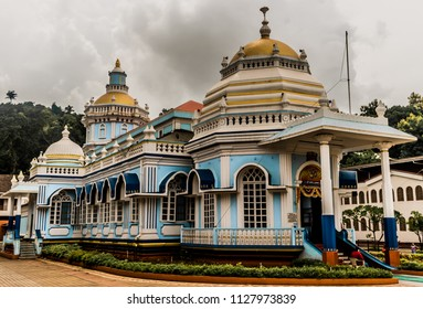 Beautiful photo of very famous Mangeshi Temple of Goa in rainy season. An example of typical south indian temples architecture