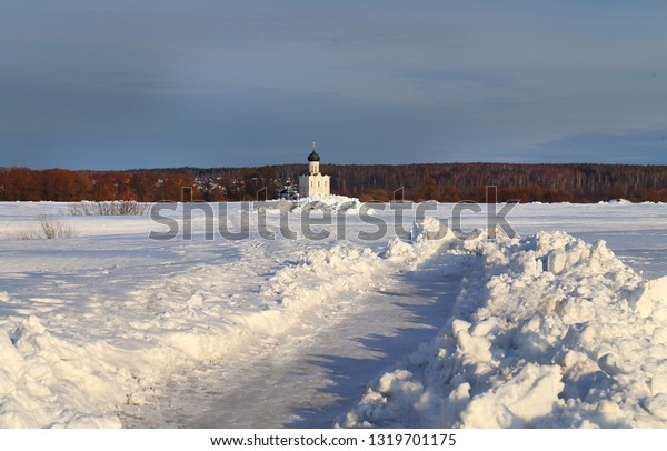 Beautiful photo of the winter landscape of the white Christian Church near Bogolyubovo