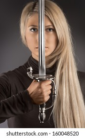 The beautiful photo of woman holding the sword.