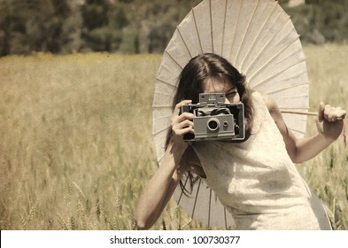 Beautiful photographer. Photo in old image style.