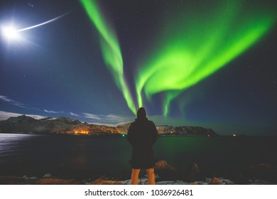Beautiful picture of massive multicolored green vibrant Aurora Borealis, Aurora Polaris, also know as Northern Lights in the night sky over Norway, Lofoten Islands