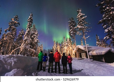 Beautiful picture of massive multicolored green vibrant Aurora Borealis, Aurora Polaris, also know as Northern Lights in the night sky over winter Lapland landscape, Norway, Scandinavia