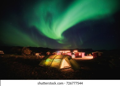 Beautiful picture of massive multicolored green vibrant Aurora Borealis, Aurora Polaris, also know as Northern Lights in the night sky over Norway, Scandinavia