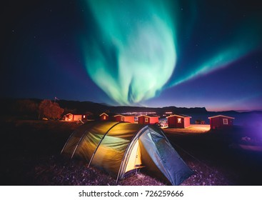Beautiful picture of massive multicoloured green vibrant Aurora Borealis, Aurora Polaris, also know as Northern Lights in the night sky over Norway, Scandinavia