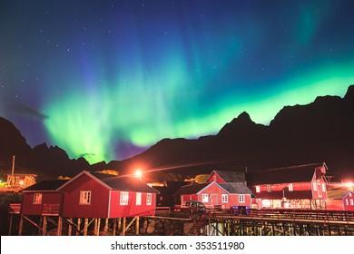Beautiful picture of massive multicoloured vibrant Aurora Borealis, Aurora Polaris, also know as Northern Lights in the night sky over Norway, Lofoten Islands
