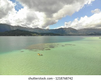 Beautiful picture showing a kayak in the waters of Kaneohe Bay, Oahu, Hawaii