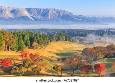Beautiful pictures of mountains and mist,Pine trees and trees change color Including a golf course in the morning at ASO,Kumamoto prefecture,Japan