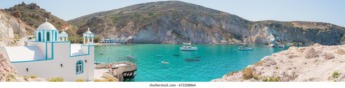 The beautiful picturesque church, beach and cliffs are all seen in this panorama of Firopotamos bay, Milos, Greece